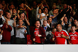 Walsall fans celebrate after Tom Bradshaw (Not Pictured) scored their first goal - Mandatory byline: Jack Phillips / JMP - 07966386802 - 11/08/15 - FOOTBALL - The City Ground - Nottingham, Nottinghamshire - Nottingham Forest v Walsall - Football League Cup Round 1