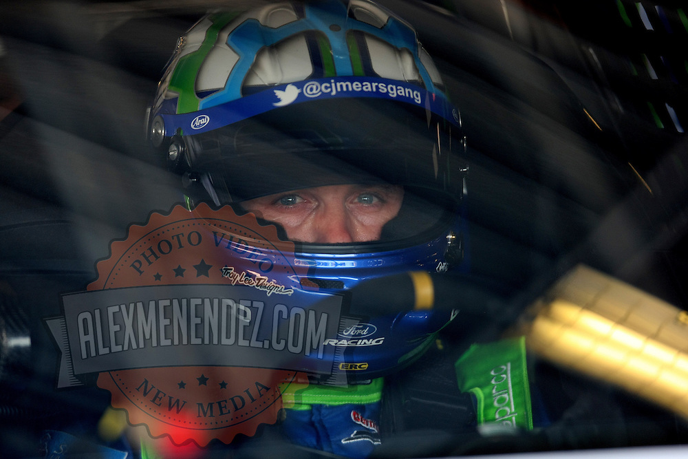 NASCAR Sprint Cup driver Casey Mears (13) is seen in the garage area during the NASCAR Coke Zero 400 Sprint practice session at the Daytona International Speedway on Thursday, July 4, 2013 in Daytona Beach, Florida.  (AP Photo/Alex Menendez)