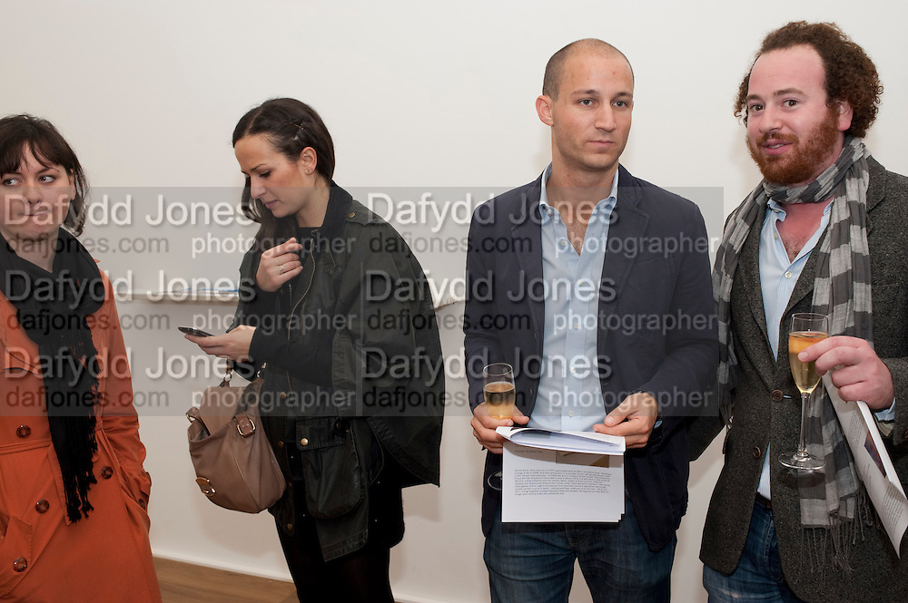 Reception of the Silent Auction for the South London Gallery.  Hauser and Wirth. Savile Row. London. 13 October 2011. <br /> <br />  , -DO NOT ARCHIVE-&copy; Copyright Photograph by Dafydd Jones. 248 Clapham Rd. London SW9 0PZ. Tel 0207 820 0771. www.dafjones.com.