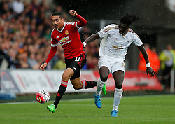 Chris Smalling of Manchester United is challenged by Bafetibis Gomis of Swansea City - Mandatory byline: Rogan Thomson/JMP - 07966 386802 - 30/08/2015 - FOOTBALL - Liberty Stadium - Swansea, Wales - Swansea City v Manchester United - Barclays Premier League.