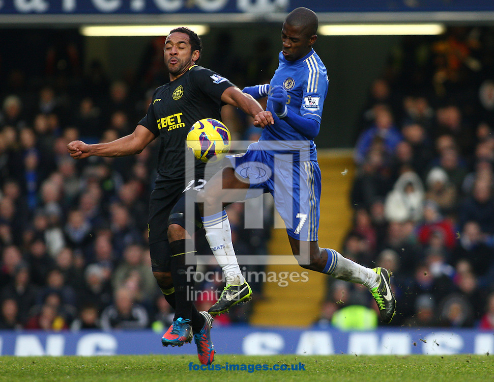 Picture by Rob Fisher/Focus Images Ltd +44 7545 398891.09/02/2013.Ramires of Chelsea and Jean Beausejour of Wigan Athletic battle for the ball during the Barclays Premier League match at Stamford Bridge, London.