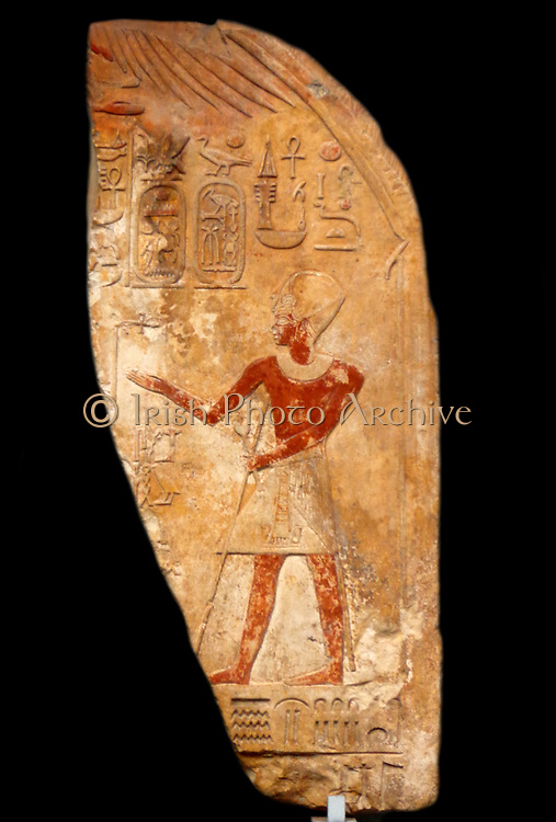 Limestone relief depicting a pharaoh showing the painted surface using a variety of colours, along with Hieroglyphics. Circa 2700 BC. Egyptian.
