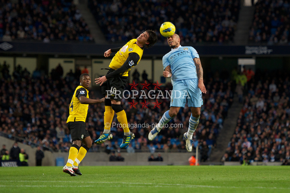 MANCHESTER, ENGLAND - Saturday, February 25, 2012: Manchester City's Nigel de Jong in action against Blackburn Rovers' Mauro Formica during the Premiership match at City of Manchester Stadium. (Pic by David Rawcliffe/Propaganda)