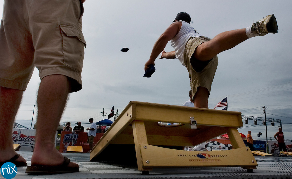 Craig Tolliver, of West Virigina, tosses a bag during a game of cornhole at the National Tailgaiting League's cornhole tournament outside of Lowe's Motor Speedway Saturday afternoon. The NTL is a newly formed organization that hopes to sponsor tailgaiting game tournaments at race tracks and other sporting events around the country.