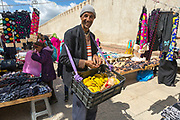 TETOUAN, MOROCCO - 5th April 2016 - Portrait of a banana fruit seller walking through the clothes market in the Tetouan Medina, Rif region of Northern Morocco.