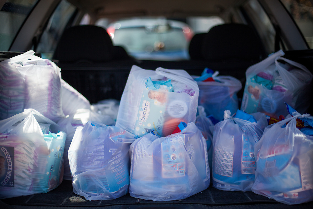 Sandwiches, children books and hygenic things such as diapers are prepared and loaded to the car for delivery to Crnik where Romina will have her lecture the same day.