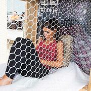 NLD/Zandvoort/20140518 - Lock me Up - Free a Girl  2014, Yolanthe Sneijder - Cabau van Kasbergen opgesloten in haar hokje