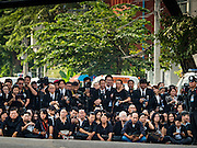 16 DECEMBER 2015 - BANGKOK, THAILAND: People line Krung Kasem Street in Bangkok during the funeral of Somdet Phra Nyanasamvara, Thailand's Supreme Patriarch. He died Oct. 24, 2013. He was ordained as a Buddhist monk in 1933 and appointed as the Supreme Patriarch in 1989. He was the spiritual advisor to Bhumibol Adulyadej, the King of Thailand when the King served as a monk in 1956. Tens of thousands of people lined the streets during the procession to pray for the Patriarch.     PHOTO BY JACK KURTZ
