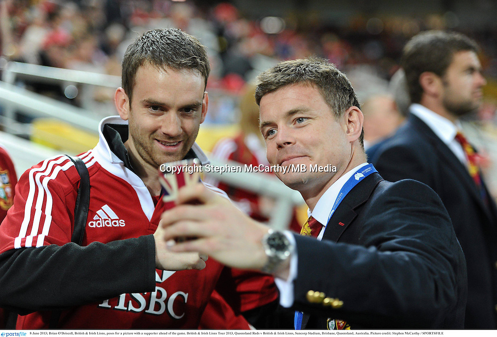 8 June 2013; Brian O'Driscoll, British & Irish Lions, poses for a picture with a supporter ahead of the game. British & Irish Lions Tour 2013, Queensland Reds v British & Irish Lions, Suncorp Stadium, Brisbane, Queensland, Australia. Picture credit: Stephen McCarthy / SPORTSFILE