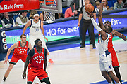 Dallas Mavericks guard Tim Hardaway Jr. (11) drives to the basket while being guarded by Toronto Raptors power forward Chris Boucher (25) rebound ready are Pascal Siakam (43) and Matt Thomas (21) while Seth Curry (30) looks on during an NBA basketball game, Saturday, Nov. 16, 2019, in Dallas. The Mavericks defeated the Raptors 110-102. (Wayne Gooden/Image of Sport)