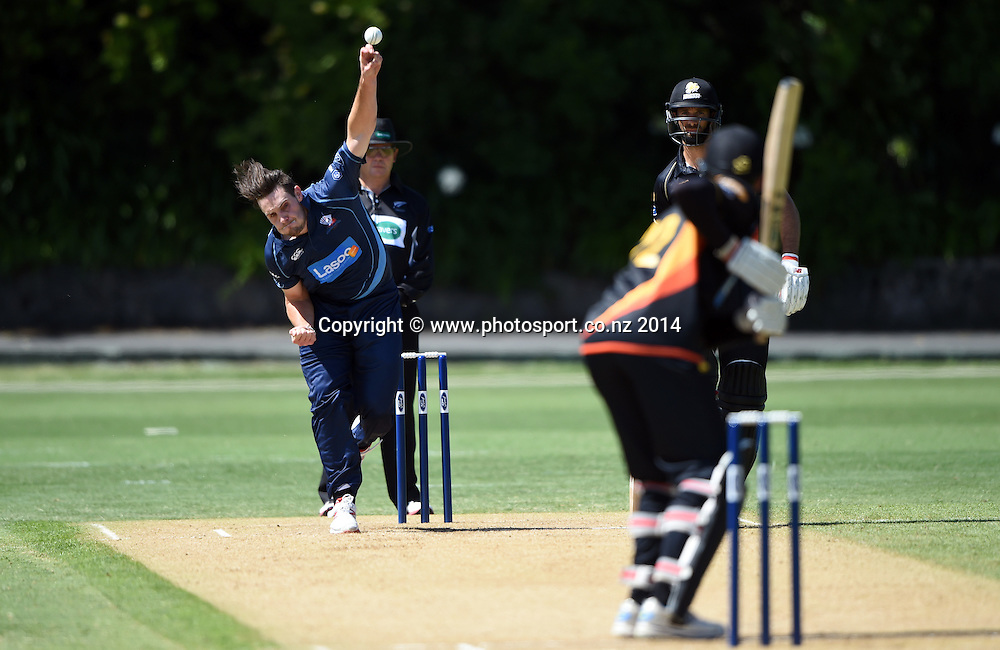 Auckland's Mitchell McClenaghan bowling during the Ford Trophy one day cricket match between Auckland Aces and Wellington Firebirds at the Eden Park Outer Oval, Auckland, New Zealand. Saturday 27 December 2014. Photo: Andrew Cornaga/www.Photosport.co.nz