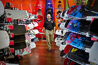 Randy Richards walks down an aisle of recreational watersports gear Wednesday at Tri-State Outfitters in Coeur d'Alene. The sporting goods retailer has transferred ownership of all four Tri-State stores in Coeur d'Alene, Moscow, Lewiston and Moses Lake, Wash. to Crown Enterprises In., Sportsman & Ski Haus.