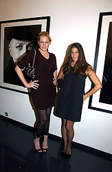 Left to right, AMY SACCO and ELIZABETH SALTZMAN at a private view of an exhibition of portrait photographs by Danish photographer Marc Hom held at the Hamiltons Gallery, 13 Carlos Place, London on 23rd October 2006.<br /><br />NON EXCLUSIVE - WORLD RIGHTS