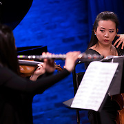 """February 9, 2015 - New York, NY : Cellist Sumire Kudo, right, performs Shulamit Ran's 'Mirage for five players' as part of The New York Philharmonic and the 92nd Street Y's presentation of """"Contact! New Music from Israel"""" at SubCulture in Manhattan on Monday night.  CREDIT: Karsten Moran for The New York Times"""