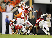 Clemson Tigers quarterback Deshaun Watson (4) gets upended on a keeper in the second half of the National Championship at Raymond James Stadium in Tampa, Monday, January 9, 2017.