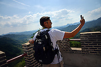 Poole College of Management Study Abroad student Amit Reddy shoots a 360 degree video selfie at the Great Wall.