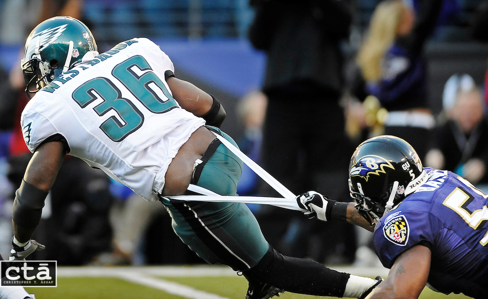 Ravens linebacker Antwan Barnes (50) stops Eagles running back Brian Westbrook (36) by the seat of his pants, relatively, for a two-yard loss in the third quarter of their game. The Ravens beat the Eagles 36-7 at M&T Bank Stadium.