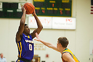 Great Danes guard Evan Singletary (0) looks to pass the ball during the men's basketball game between the Albany Great Danes and the Vermont Catamounts at Patrick Gym on Wednesday night January 28, 2015 in Burlington, Vermont. (BRIAN JENKINS, for the Free Press)