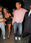 19.SEPTEMBER.2009 - LONDON<br /> <br /> KATIE PRICE LEAVING THE TROXY THEATRE, EAST LONDON AT 11.30PM WEARING A TOP WITH CHAMP ON IT AFTER GOING TO WATCH BOYFRIEND ALEX REID COMPETE IN A KICK BOXING MATCH SHE WAS JOINED BY MICHELLE HEATON, HORSE TRAINER ANDREW GOULD AND A COACHFULL OF OTHER GUESTS. ALEX CAME OUT 10 MINUTES LATER BRUISED AND WITH WATER ALL OVER HIM, THEY THEN HEADED ONTO MOVIDA CLUB AND KATIE WORE ALEX'S NEW BELT THAT HE HAD WON INTO THE CLUB. THEY STAYED TILL 3.00AM AND BOTH LEFT LOOKING VERY WORSE FOR WEAR WITH KATIE NEARLY FALLING OUT HER TOP AND ALEX BLEEDING ON HIS EYEBROW WHICH NEEDED A PLASTER. THEY THEN WENT TO THE BRITISH LUXURY CLUB AND PARTIED TILL 5.30AM BEFORE CALLING IT A NIGHT.<br /> <br /> BYLINE: BLOOMS/EDBIMAGEARCHIVE.COM<br /> <br /> *THIS IMAGE IS STRICTLY FOR UK NEWSPAPERS & MAGAZINES ONLY*<br /> *FOR WORLDWIDE SALES & WEB USE PLEASE CONTACT EDBIMAGEARCHIVE - 0208 954-5968*