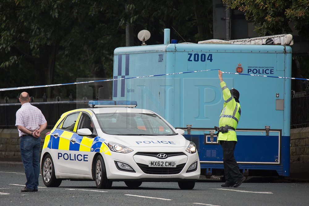 """© Licensed to London News Pictures. 27/07/2015. Salford, UK. Scene on Manchester Road , Clifton , Salford where Paul Massey - known as Salford's """"Mr Big"""" was shot dead last night (26th July 2015 ) . Photo credit: Joel Goodman/LNP"""