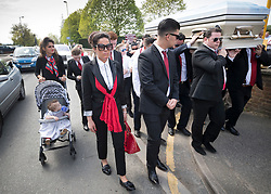 © Licensed to London News Pictures. 21/04/2018. Cobham, UK. Family members follow the coffin of Queenie, Elizabeth Doherty from Sacred Heart Church in Cobham, Surrey. Elizabeth Doherty, whose son Paddy Doherty is known for appearing on My Big Fat Gypsy Wedding and winning Celebrity Big Brother 8, died of a heart attack earlier this month. Paddy Doherty claimed his mother has died of a 'broken heart' following the death of her husband almost a year ago. Photo credit: Peter Macdiarmid/LNP