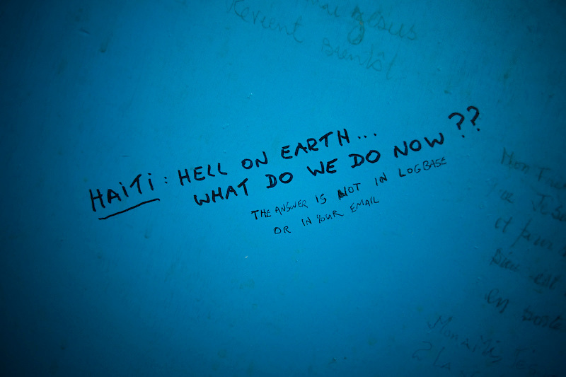 Bathroom stall wall at the UN Logistics Base, Port Au Prince, Haiti. Photo by Ben Depp.1/22/2010.