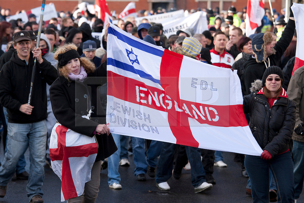 © under licence to London News Pictures 27/11/2010 today picture.The English Defence League held a National protest march through Nuneaton, Warwickshire earlier today. Police from forces as far away as Gloucestershire were called upon to contain the massed ranks of demonstraters. Protesters taking part in the march..Picture credit: Dave Warren/London News Pictures...
