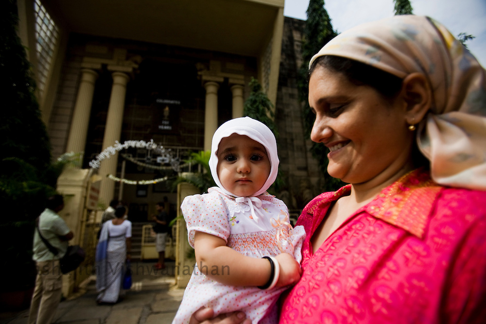 A Parsi child looks on as her family enters the Kappawala Agiary, or Fire Temple, on Navroze, the Parsi new year, in Mumbai, India, Tuesday, Aug. 19, 2008. Parsis, also known as Zoroastrians, worship fire and are followers of the Bronze Age Persian prophet Zarathustra. According to estimates there are only 150,000 Zoroastrians in the world today and more than 80,000 live in India, mostly in Mumbai. Photographer:Prashanth Vishwanathan/Atlas Press