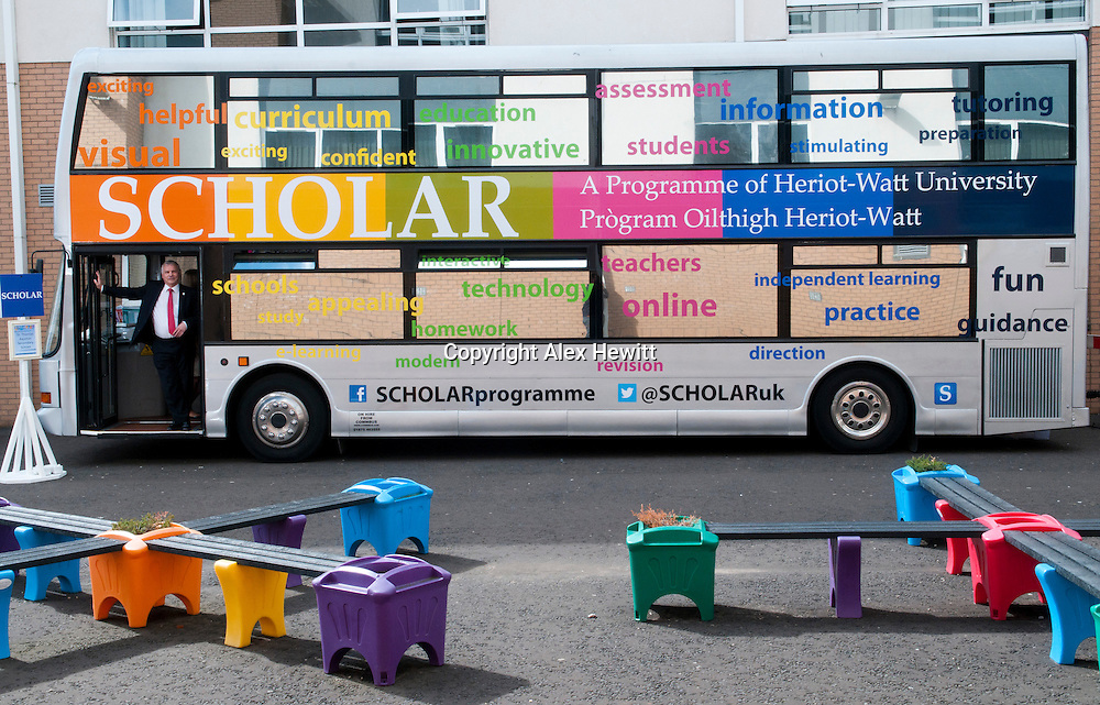Scholar Bus at St Thomas Aquinas secondary school in Glasgow<br /> <br /> 2013 saw members of the SCHOLAR team travel around Scotland for one week in a dedicated SCHOLAR Bus.<br /> <br /> Aside from the Scholar Team the photography here involved:<br /> <br /> Maureen McKenna, Executive Director of Education, Glasgow City Council<br /> <br /> Stephen Watters, Quality Improvement Officer-Mathematics, Glasgow City Council<br /> <br /> Andrew McSorley, Head Teacher, St. Thomas Aquinas RC Secondary School<br /> <br /> John Dowds, Deputy Head Teacher, St. Thomas Aquinas RC Secondary School<br /> <br /> Professor Phillip John, Executive Chair, SCHOLAR Forum<br /> <br /> Agnes Cosgrove, SCHOLAR Business Manager<br /> <br /> Jim McGill, SCHOLAR Co-ordinator<br /> <br /> Copyright Alex Hewitt<br /> 07789 871 540