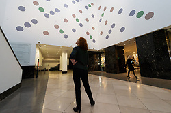 © Licensed to London News Pictures. 16/01/2019. London, UK. Visitor views artist Brigitte Riley's Messengers, her new large scale wall painting in Anneberg Court of the National Gallery. Photo credit: Ray Tang/LNP