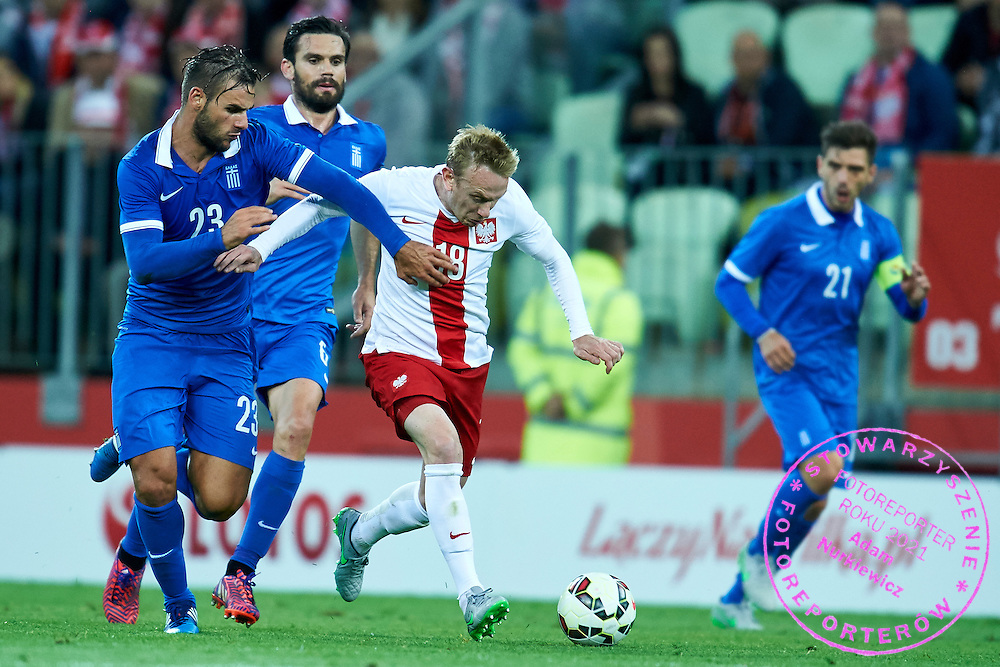 (R) Sebastian Mila from Poland fights for the ball with (L) Panagiotis Tachtsidis from Greece during international friendly soccer match between Poland and Greece at PGE Arena Stadium on June 16, 2015 in Gdansk, Poland.<br /> Poland, Gdansk, June 16, 2015<br /> <br /> Picture also available in RAW (NEF) or TIFF format on special request.<br /> <br /> For editorial use only. Any commercial or promotional use requires permission.<br /> <br /> Adam Nurkiewicz declares that he has no rights to the image of people at the photographs of his authorship.<br /> <br /> Mandatory credit:<br /> Photo by &copy; Adam Nurkiewicz / Mediasport