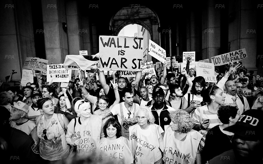 Occupy Wall Street is a people powered movement for democracy that began in America on September 17 with an encampment in the financial district of New York City.  Image © Bill Kotsatos/Falcon Photo Agency