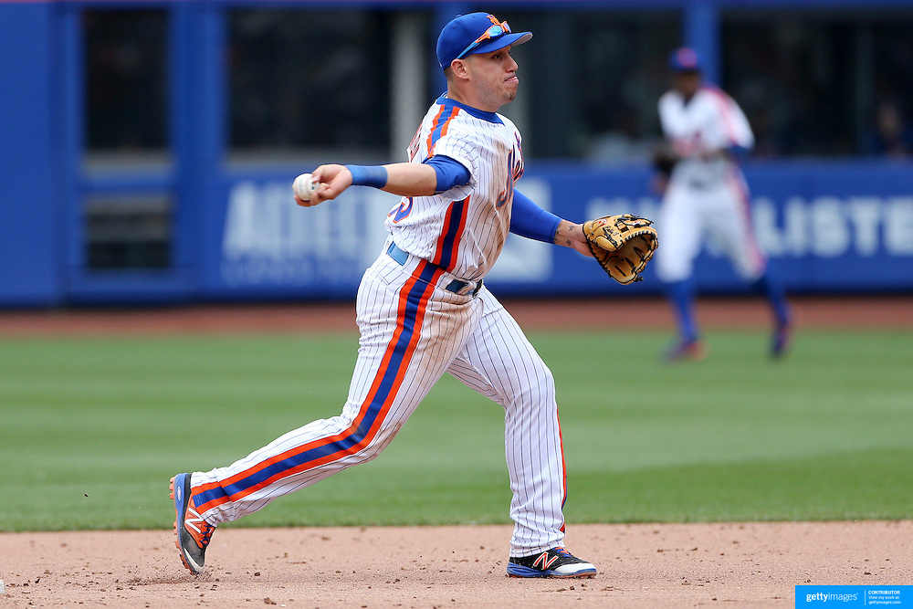NEW YORK, NEW YORK - May 22:  Shortstop Asdrubal Cabrera #13 of the New York Mets turns a double play during the Milwaukee Brewers Vs New York Mets regular season MLB game at Citi Field on May 22 2016 in New York City. (Photo by Tim Clayton/Corbis via Getty Images)