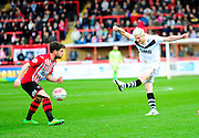 Port Vale's Ryan McGivern has a shot at goal during the The FA Cup match between Exeter City and Port Vale at St James' Park, Exeter, England on 6 December 2015. Photo by Graham Hunt.