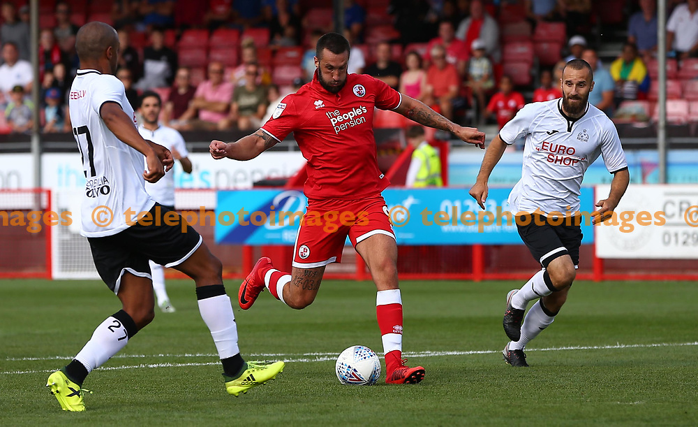 Crawley's Ollie Palmer scores the opening goal  during the pre season friendly between Crawley Town and KSV Roeselare at The Broadfield Stadium, Crawley , UK. 28 July 2018.