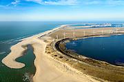 Nederland, Zuid-Holland, Rotterdam, 18-02-2015; zicht op De Slufter vanaf de Brielse Gat, Tweede Maasvlakte (MV2) in het verschiet. De Slufter is een grootschalige opslagplaats voor vervuild havenslib. De verontreinigde baggerspecie komt voort uit het onderhoudsbaggerwerk in de Rotterdamse haven waarbij de haven op diepte wordt gehouden. Op de Tweede Maasvlakte wordt gewerkt aan de inrichting van de haventerreinen.<br /> The Slufter area in the South-West of the Netherlands, large-scale depot of contaminated harbor sludge from the Port of Rotterdam. Along the edge of the Slufter windmills are built. The Second Maasvlakte with new harbours in the background<br /> luchtfoto (toeslag op standard tarieven);<br /> aerial photo (additional fee required);<br /> copyright foto/photo Siebe Swart