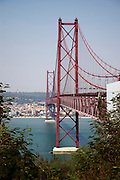 Bridge over Tagus river as seen from the margin opposite to Lisbon.