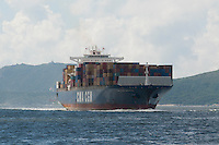 Cargo ships from all over the world arrive in and depart from Hong Kong harbour.