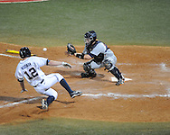 Ole Miss' J.B. Woodman (12) is tagged out at home vs. Auburn's Blake Austin at Oxford-University Stadium in Oxford, Miss. on Friday, April 4, 2014. Mississippi won 8-5.