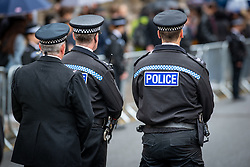 © Licensed to London News Pictures. 14/10/2019. Oxford, UK. Police officer's watch on as the funeral procession makes its way in to Christ Church Cathedral in Oxford city centre for the funeral of Thames Valley Police officer PC Andrew Harper. Photo credit: Peter Manning/LNP