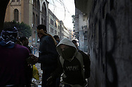 EGYPT, Cairo :  Egyptian protesters take cover during clashes with security forces near the Interior Ministry in Cairo, Egypt, Saturday, Feb. 4, 2012..