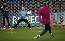 Manchester City goalkeeper Ederson (left) warms up prior to the match