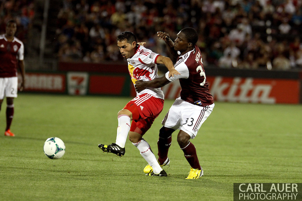 July 4th, 2013 - New York Red Bulls forward Fabian Espindola (9) fights off the aggressive play by Colorado Rapids defender German Mera (33) in second half action of the Major League Soccer match between New York Red Bulls and the Colorado Rapids at Dick's Sporting Goods Park in Commerce City, CO