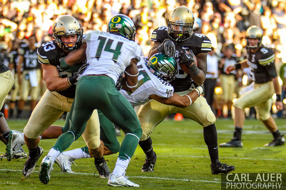 October 5th, 2013:  Colorado Buffaloes sophomore fullback Clay Jones (48) is stopped by University of Oregon Ducks sophomore linebacker Rodney Hardrick (48) in second quarter action of the NCAA football game between the University of Oregon Ducks and the Colorado Buffaloes at Folsom Field in Boulder, Colorado