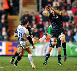 Francois Trinh-duc (Montpellier) kicks the ball away but Jamie Gibson (Leicester) charges him down - Photo mandatory by-line: Patrick Khachfe/JMP - Tel: Mobile: 07966 386802 08/12/2013 - SPORT - RUGBY UNION -  Welford Road, Leicester - Leicester Tigers v Montpellier - Heineken Cup.