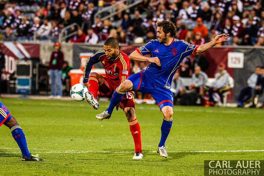 April 6th, 2013 - Real Salt Lake forward Álvaro Saborío (15) and Colorado Rapids midfielder Brian Mullan (11) fight for the ball in front of the goal during second half action of the MLS match between Real Salt Lake and the Colorado Rapids at Dick's Sporting Goods Park in Commerce City, CO