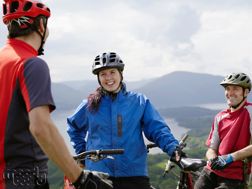 Three cyclists outdoors smiling