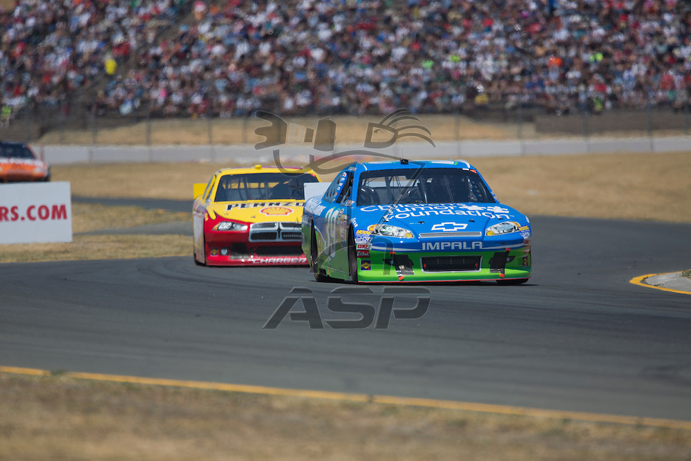 SONOMA, CA - JUN 24, 2012:  Ryan Newman (39) brings his car through the turns during the Toyota Save Mart 350 at the Raceway at Sonoma in Sonoma, CA.