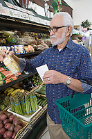 Senior man vegetable shopping
