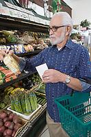 Senior man vegetable shopping